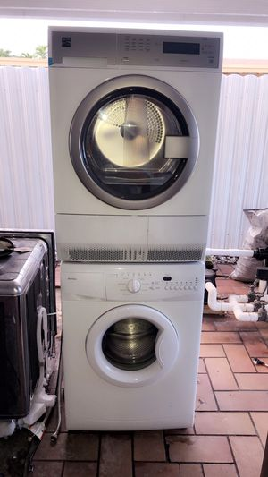 KENMORE,MAYTAG WHITE WASHER AND DRYER. KENMORE DRYER IS BRAND NEW AND WASHER MAYTAG WAS ONLY USED FOR FLOOR DISPLAY BRAND NEW WITH WARRANTY for Sale in Hialeah, FL