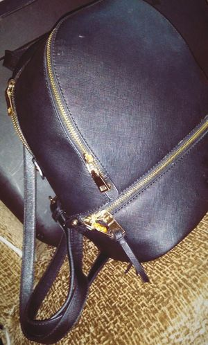 Black and gold backpack purse for Sale in Columbus, OH