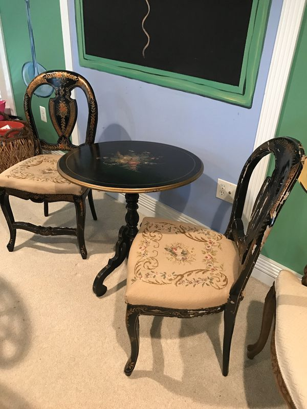 Antique 2 chairs and embroidery chairs . Table has hand painted . Very sturdy has gold , green , red , yellow hand painted in the middle. These are