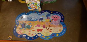 Book and puzzle . Let's Look! For baby For baby for Sale in Pomona, CA