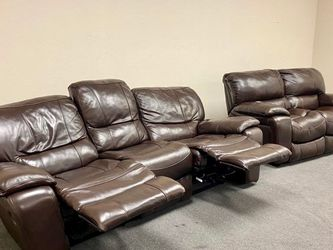 Beautiful Leather Couch recliner W Loveseat. Fine Leather. Made by Ashley. Great price. Won't last. Delivery available for a small fee. for Sale in Frisco,  TX