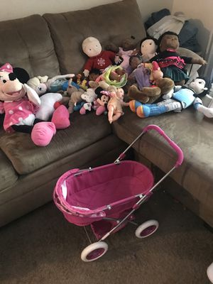 Dolls, stuffed animals, and buggy for Sale in Norcross, GA