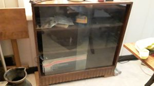 Sliding glass book case for Sale in Atlanta, GA