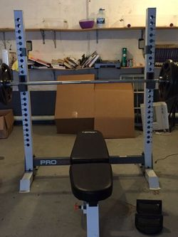 Squat Rack/bench Press + 300lbs Olympic Weight for Sale in Portland,  OR