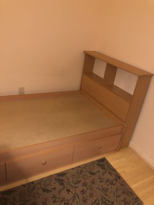 Wooden twin bed frame with headboard shelving and added storage underneath! for Sale in Baltimore, MD