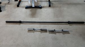 Olympic barbell 7 ft and pair of Olympic dumbbells for Sale in Martinsburg, WV