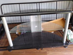 Glass tv stand for Sale in Dade City, FL