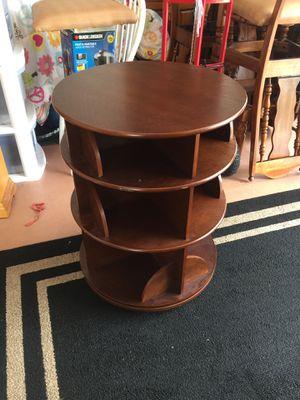 Raund table brown. 4 shelves spinning for Sale in Boynton Beach, FL