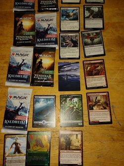 Kaldheim And Zendikar Packs All Unopened+One Pack Opened Cards Laid Out for Sale in Oakland,  CA