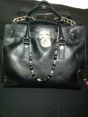M.K. Beautiful black leather. With Gold. Trim. $$$ for Sale in Denver, CO