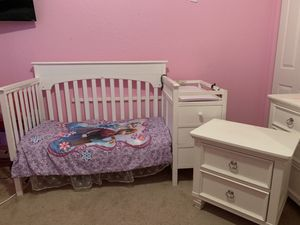 2 in 1 White crib and changing table along with dresser and nightstand for Sale in Port St. Lucie, FL