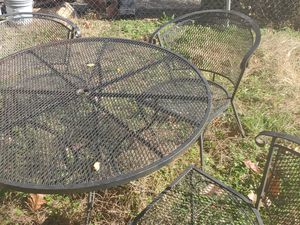 Black metal outside table and four chairs for Sale in Halethorpe, MD
