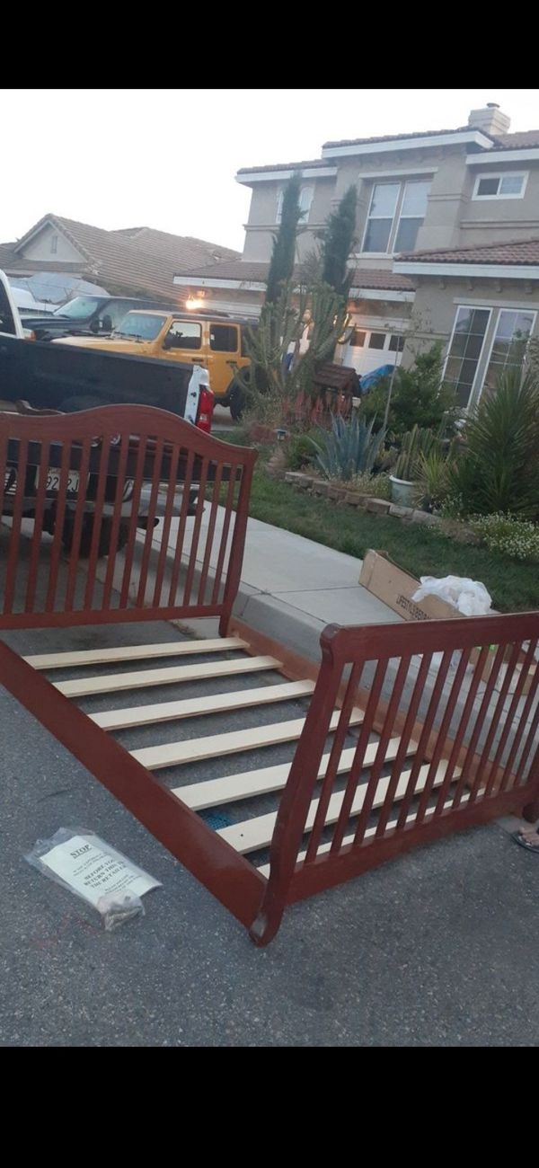 Solid wood bed frame size full two side rails and board and hardware is brand new still in the box