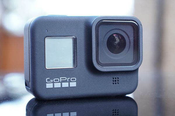GoPro 8 w/ 4 extra batteries and battery charger (water resistant)