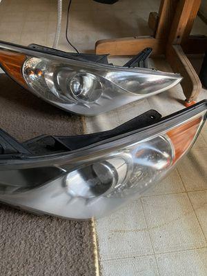 2012 Hyundai sonata headlamp Drivers and passenger side for Sale in Riverside, CA