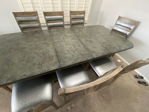 Poundex convertible 8 chair + Dining table for Sale in Scottsdale, AZ