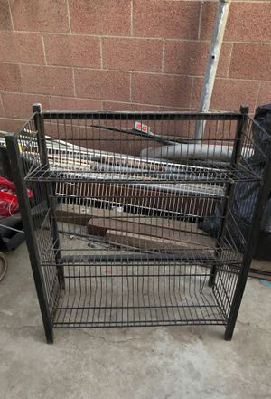 Black metal rack can be used as storage shelves, to organize, shoes can be used for different stuff! It's a great deal! for Sale in Bell Gardens, CA