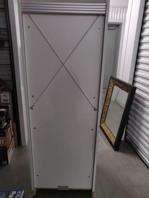 Rolling door cabinet