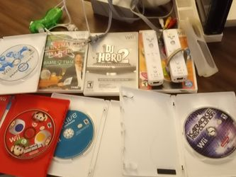 Black Nintendo Wii: Comes With Two Controls, All Wires, 2 Nunchucks, Some Games. for Sale in Chula Vista,  CA