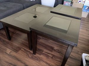 Lightly used espresso coffee/end table set with black tempered glass accent for Sale in Los Angeles, CA