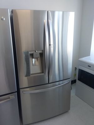 Lg, ge French doors stainless steel refrigerator used good condition 90days warranty for Sale in Mount Rainier, MD