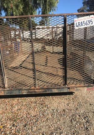 Utility trailer title and registration is OK 12 feet long 7 feet wide4 feet tall all around the mash Flores middle play gates go down $2350 title and for Sale in Menifee, CA