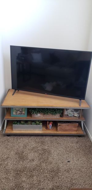 """Solid wood TV stand with two shelves 48"""" x 25"""" for Sale in Fresno, CA"""