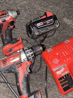On sale milwakee kit hammer 1/2 & impact drills & 5.0 battery & charger $$$210 firm in oakland for Sale in Oakland,  CA