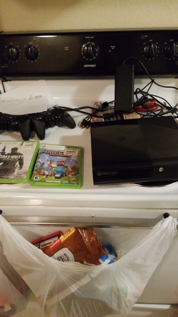 Xbox 360 with three games and a large 200 to 300 GB SD card in it you can hook up to my TV to see that everything works