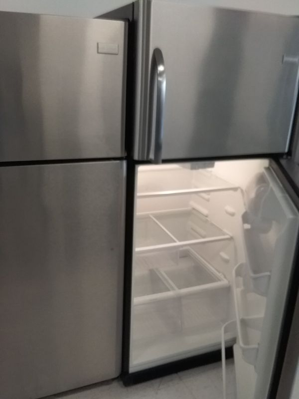 Frigidaire top and bottom stainless steel refrigerator used good condition 90days warranty