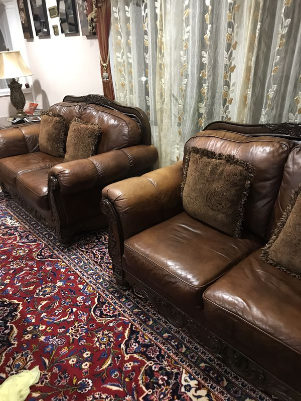 3 leather brown couches and matching coffee table