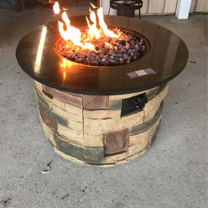 Brand New BOND Propane Fire Pit With Lava Rocks And Brand New Regulator. Comes With Propane Tank for Sale in Alexandria, LA