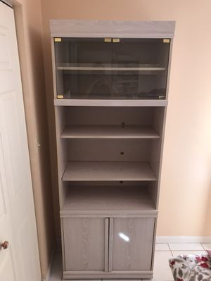 Bookshelves with two closed compartments and light for Sale in North Miami Beach, FL