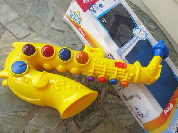 Toy Band .. Yellow Saxophone .. Wind Instrument by Bontempi made in Italy. It is new and sweet.. the box has storage damage