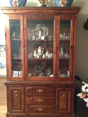 Nice two pieces China cabinet complete with light inside for Sale in Palmdale, CA