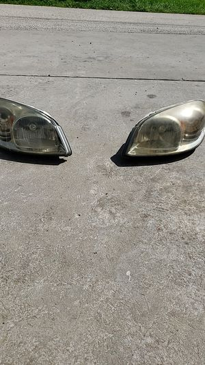 2009 chevy cobalt headlights for Sale in Freedom, PA