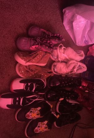 Lil girls shoes size 7 and 8 one pair off uggs and 4 pair of boots and one pair of Jordan's and one pair of pumas and one pair of gap shoes for Sale in Washington, DC