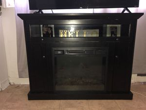 Tv stand with Heater great condition and brand new for Sale in Paterson, NJ