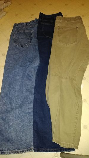 3 pairs of men's pants, KuhL, Gold Legendary & Carhartt for Sale in Charlotte, NC