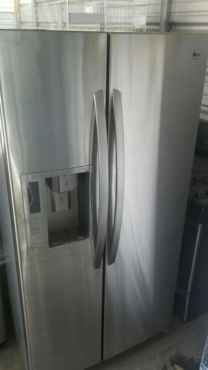 LG stainless steel refrigerator with Free delivery installation & 6 month warranty! for Sale in Lakewood, CO