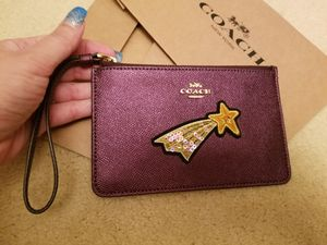 NWT COACH Purple ( Metallic Raspberry)Wristlet With Star Embellishment for Sale in Germantown, MD
