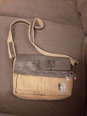 Attack on titan small messenger bag with charms for Sale in Denver, CO
