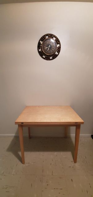 Solid wood table opens to larger table top for Sale in The Bronx, NY