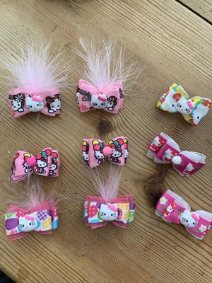 Lot of 9 hello kitty hair bows/clips for Sale in San Rafael, CA