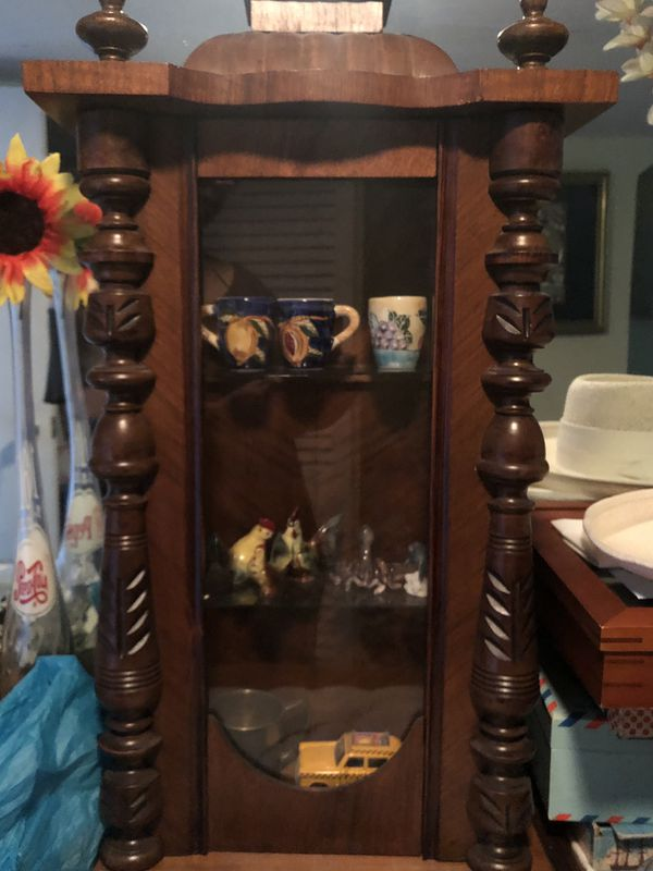 Beautiful carved antique clock cabinet shelf