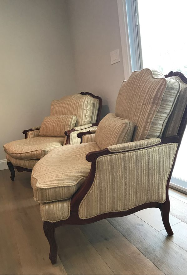 2 living room chairs by Norwalk Furniture Cherry/ Mahogany wood tone with cream colored fabric