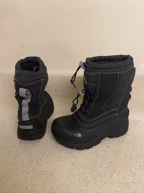 The North Face boots , kids size 2.
