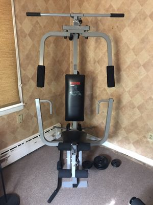 Weider 8920 Home Gym with York Cast Iron Plates for Sale in North Adams, MA