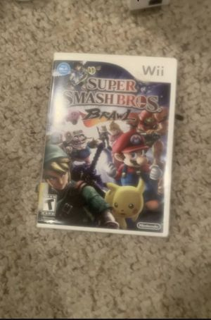 Nintendo Wii with 2 remotes and super smash bro's brawl game for Sale in Woodstock, MD