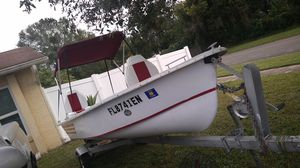 """14'10""""FT FIBER GLASS MARINER BOAT..TRAILER AND 9.8 MERCURY OUTBOARD MOTOR PAPER WORK IN HAND..BOAT TITLE..TRAILER REGISTRATIONS for Sale in Tampa, FL"""